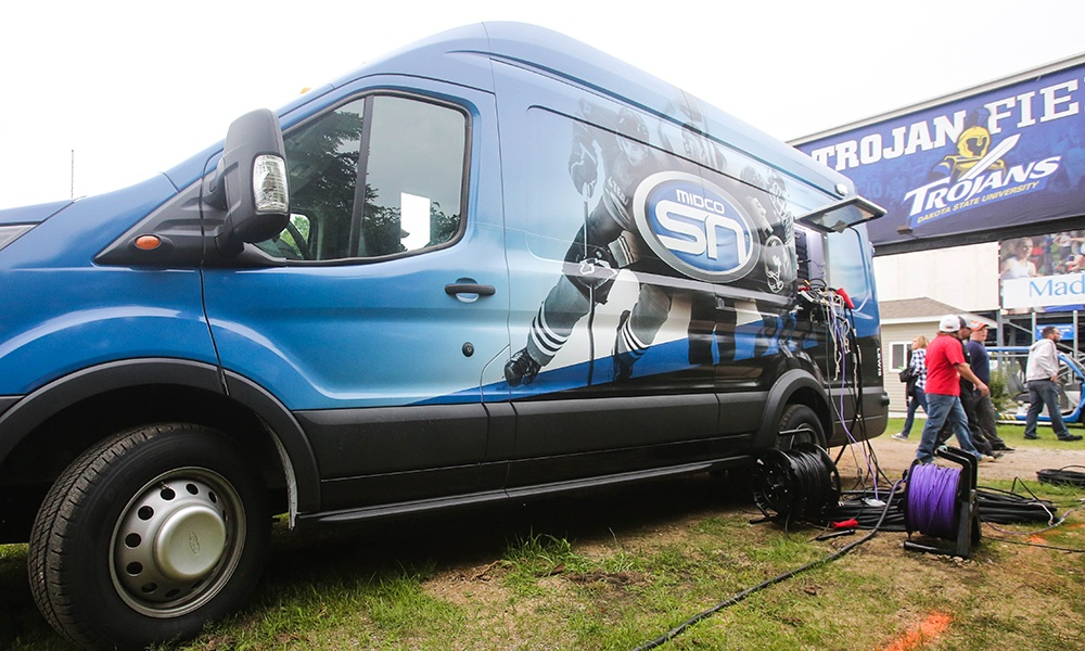 Midco Sports Network has expanded coverage with its new central production model, an agile van that makes travel less burdensome on the crew.