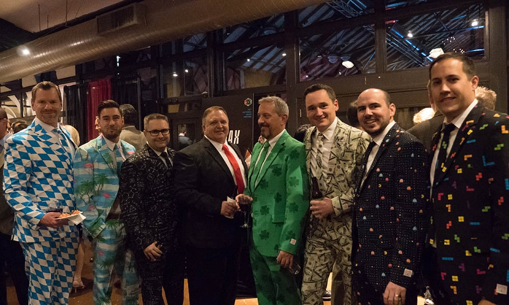 The San Diego sales staff dressed in full-print suits during Casino Night at the National Sales Meeting. The suits had patterns of money, Pac Man, a Hawaiian-theme, and math equations.