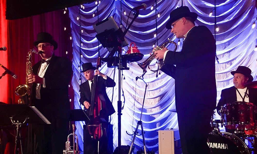 """""""The Day Jobs,"""" a band led by COO Joel Lehman, played during Casino Night at the National Sales Meeting."""